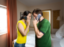 Angry man and woman talking by mobile phones in the room
