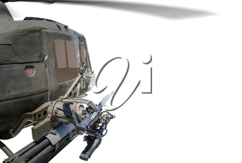 Closeup of army helicopter with machine gun isolated on white background.