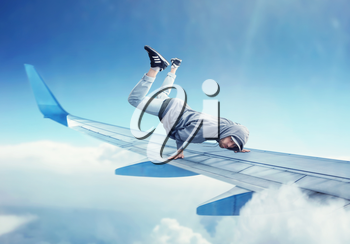 Dance performer, dancing exercise on the plane wing. Modern dance style. Male dancer in the air