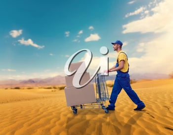Male courier with trolley in desert. Distribution business. Cargo delivery. Empty, clear containers. Logistic service