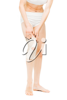 Joint ache, woman with elastic bandage, knee pain, white background. Female person in lingerie, medical advertising or concept