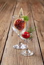 Dried tomato and slice of blue cheese in wine glass