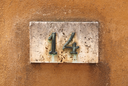 House number on a weathered wall