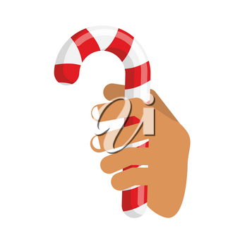 Hand and Candy Cane. Arm holding Christmas peppermint lollipop. Fingers and mint stick
