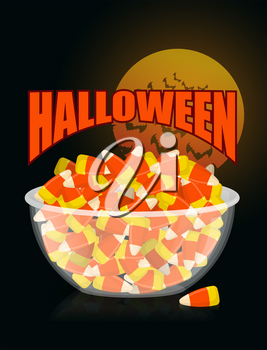 Halloween. bowl and candy corn.Moon and bat. Sweets on plate. Traditional treat for terrible holiday.