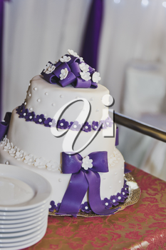 Great wedding cake with purple decorations.