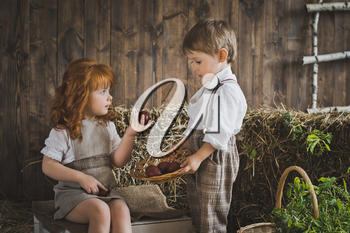 Children play with Easter eggs in the barn.