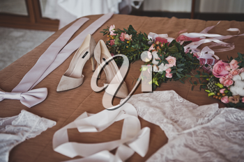 Clothing and jewelry of the bride before the ceremony.