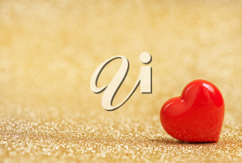 red hearts on a table, red hearts on golden background