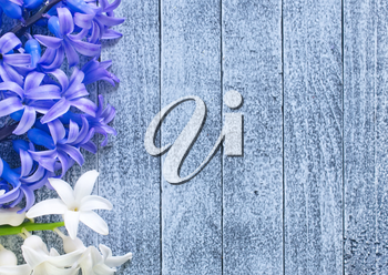 flowers on the wooden table, spring background