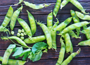 green peas on a table, fresh peas on the wooden background