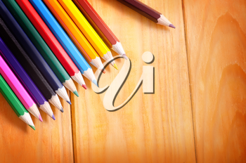 color pencils on wooden background, school supplies