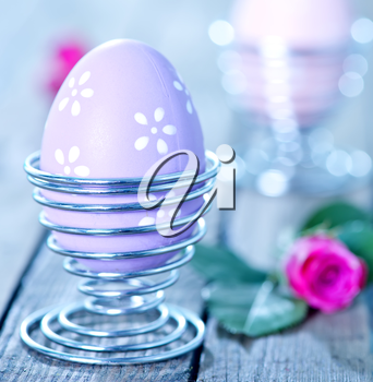 easter eggs and flowers on a table