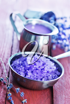 violet sea salt in metal bowl and on a table