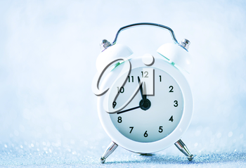 white clock on the white table, christmas background
