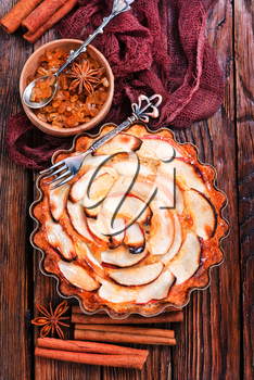 apple pie with cinnamon on a table