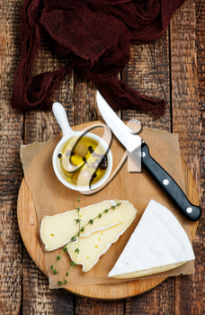 cheese on board and on a table