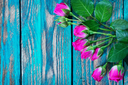 flowers on wooden background, red roses on a table