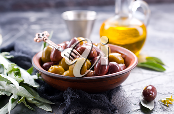 olives in bowl and on a table