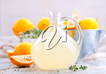 fresh lemon drink in glass jug and on a table