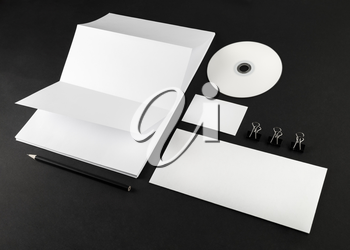 Blank stationery and corporate id template on black background.