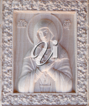 Carving on the machine with numerical control. Cut cutter machine icon of the Virgin Mary.