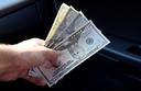 Hand transmitter dollars. Transferring money out of the hands. American dollars in a hand.
