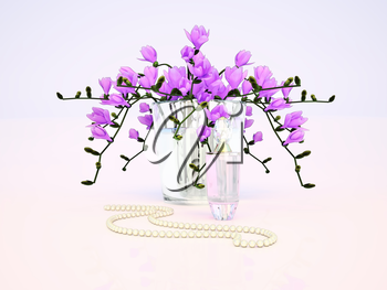 Freesia and perfume bottle on gray background.