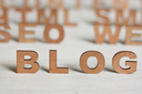 the word blog with wooden letters on a background of blurred letters,make a web site,blog