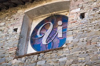details of architecture, historical buildings of Italy. Stone walls and delicate stained glass Window.