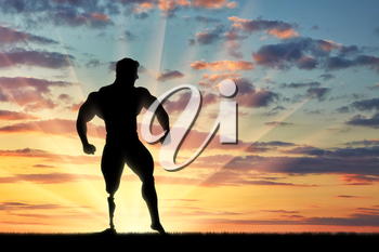 Disabled bodybuilder with prosthesis on her leg is in pose on sunset. Concept handicapped and sport