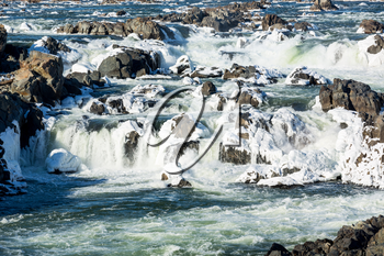 Great Falls on Potomac river outside Washington DC in winter with ice forming on the cascades and snow on the rocks