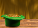 Treasure of pure gold coins inside a green velvet hat on wooden table to celebrate luck on St Patrick's Day of March 17th