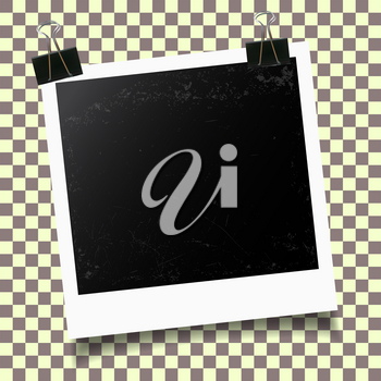 Retro photo frame with binder clip on checkered background. Vector illustration.