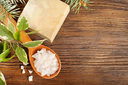 Aromatic bath salt in a wooden spoon and bar of soap