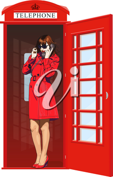 Beautiful young girl in bright clothes speak the English classic red phone booth