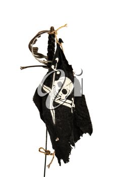 Black pirate flag winding up in the wind tied with a rope to an old sword