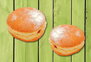 Two donuts with strawberry jam filling.