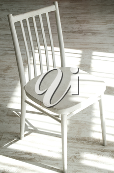 Empty old wooden chair isolated on light background.