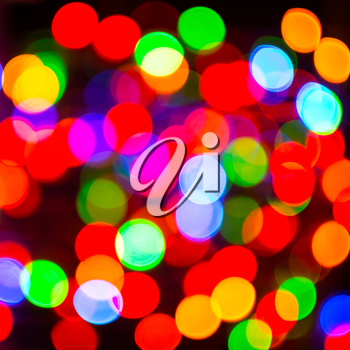 Multicolor lightbulb background, square. Bokeh background