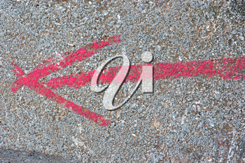 Arrow sign painted on stone surface. Abstract background texture.