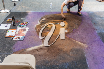 REDMOND, WA. /  USA - AUGUST 19TH 2018: An artist works at the Chalkfest event in Redmond, Washington.The location is Redmond Town Center.