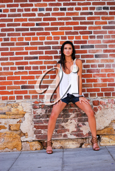 Young female model brunette pretty spring summer top with brick red background
